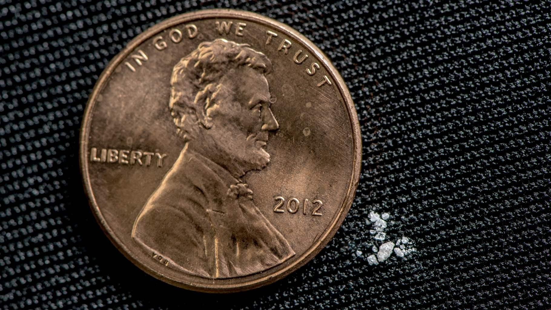 Picture of a U.S. penny next to milligrams of fentanyl, which is a fatal dose for most drug users. DEA