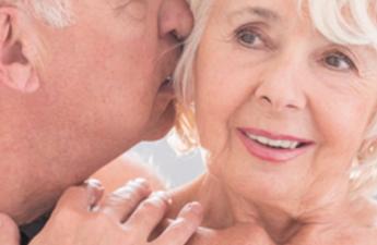 Older couple kissing.