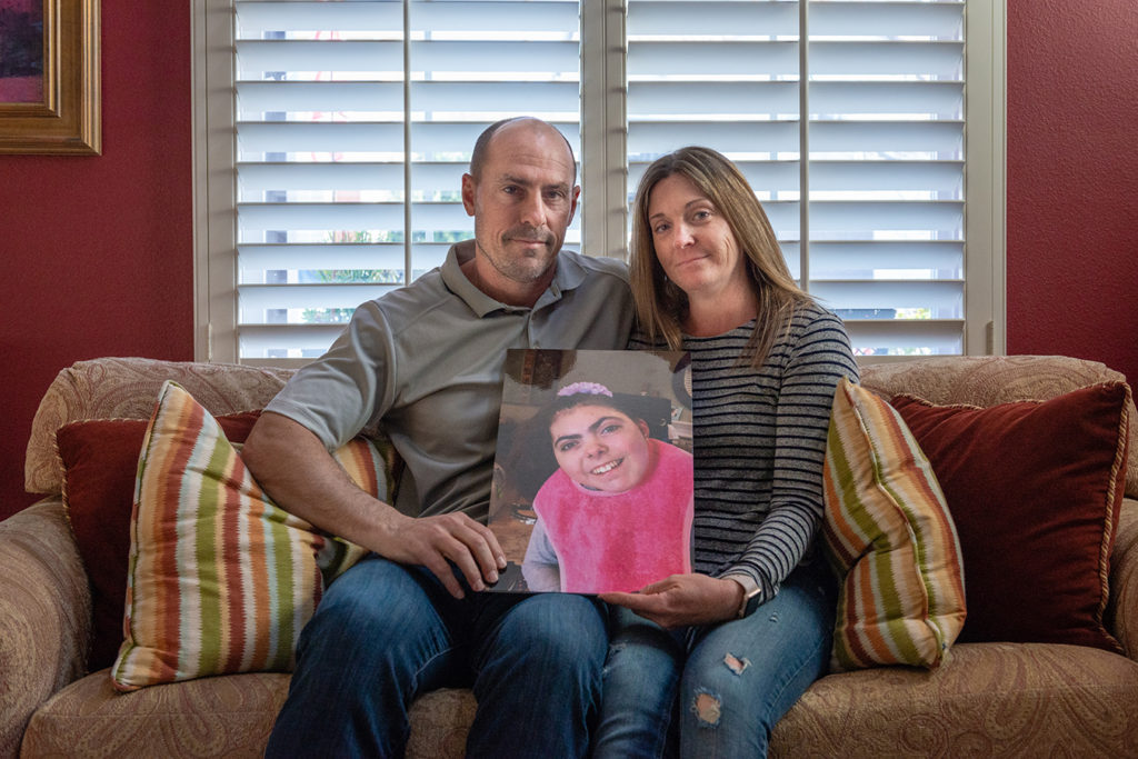 Bobby and Tara Dilliplaine hold a photo of daughter Brooke, who suffered complications when she was given medication she was allergic to. (She later died of causes unrelated to the EHR issue.)(HEIDI DE MARCO/KHN)