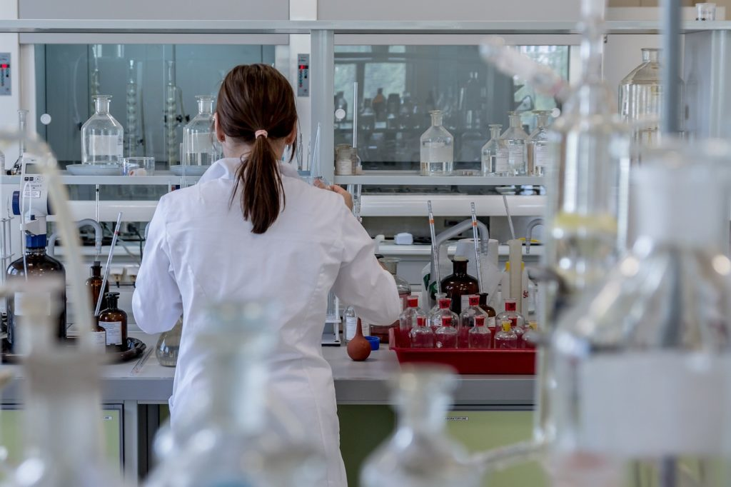 Woman researcher at laboratory lab bench research.