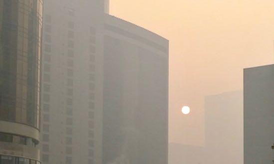 Air pollution pale sun office blocks