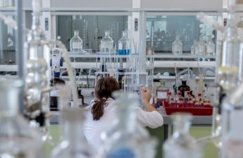 woman works in a scientific laboratory