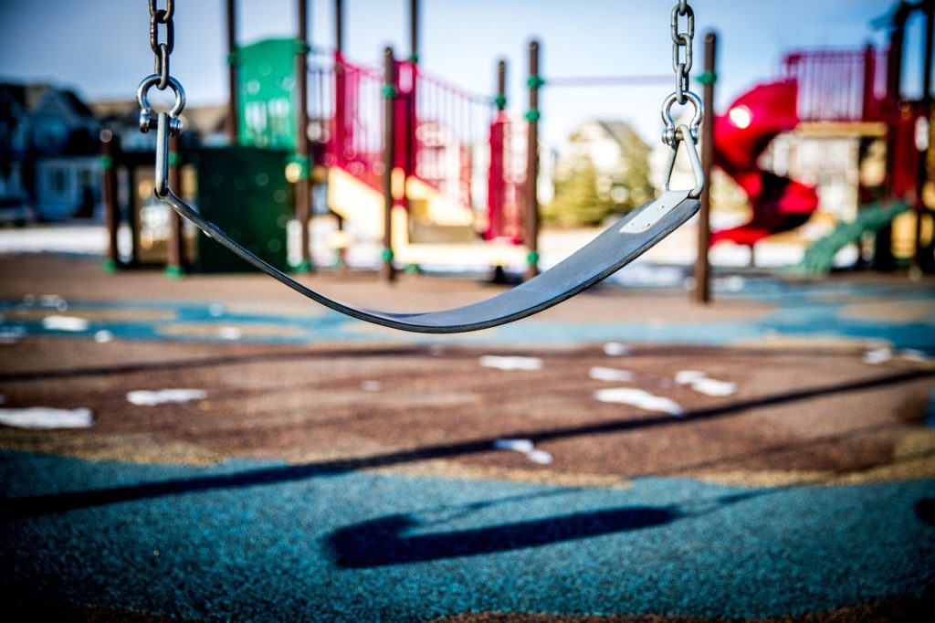 Child's swing in an empty playground