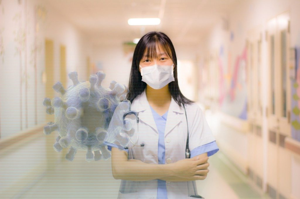 Nurse wearing a face mask with an illustration of a coronavirus superimposed