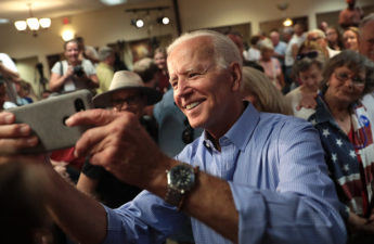 Joe Biden in shirtsleeves takes selfie with supporters
