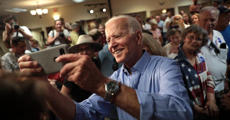 Joe Biden in shirtsleeves takes selfie with supporters